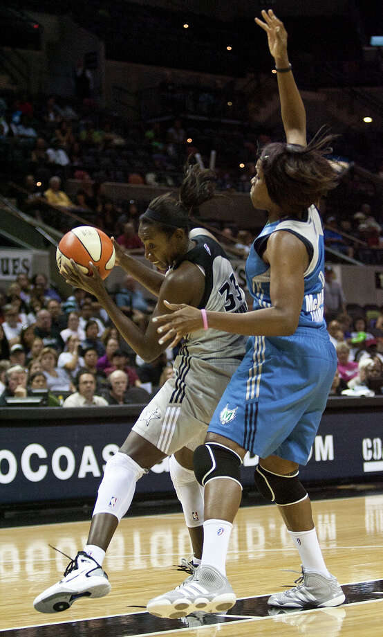 San Antonio Silver Stars' Sophia Young 33, guards the ball from Minnesota Lynx' Taj McWilliams-Franklin, 8 Sunday, July 31, 2011 at the AT&T Center. The Stars lost in the final seconds 70-69. SALLY FINNERAN/sfinneran@express-news.net Photo: SALLY FINNERAN, Express-News / © SAN ANTONIO EXPRESS-NEWS