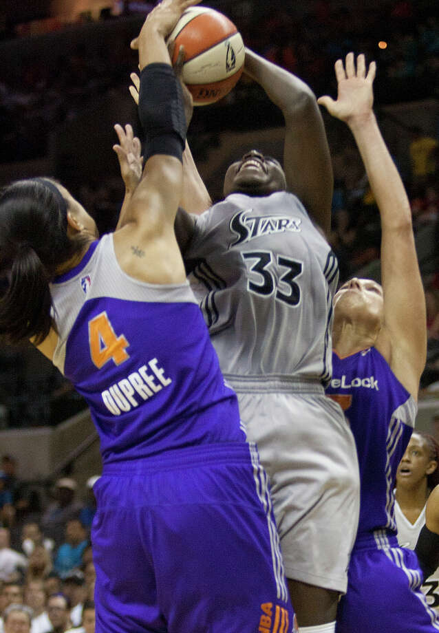 Phoenix Mercurys' Candice Dupree, 4, blocks against San Antonio Silver Stars' Sophia Young Thursday, July 28, 2011 at the AT&T Center. The Silver Stars beat the Mercury 102-91. SALLY FINNERAN/sfinneran@express-news.net Photo: SALLY FINNERAN, Express-News / © SAN ANTONIO EXPRESS-NEWS
