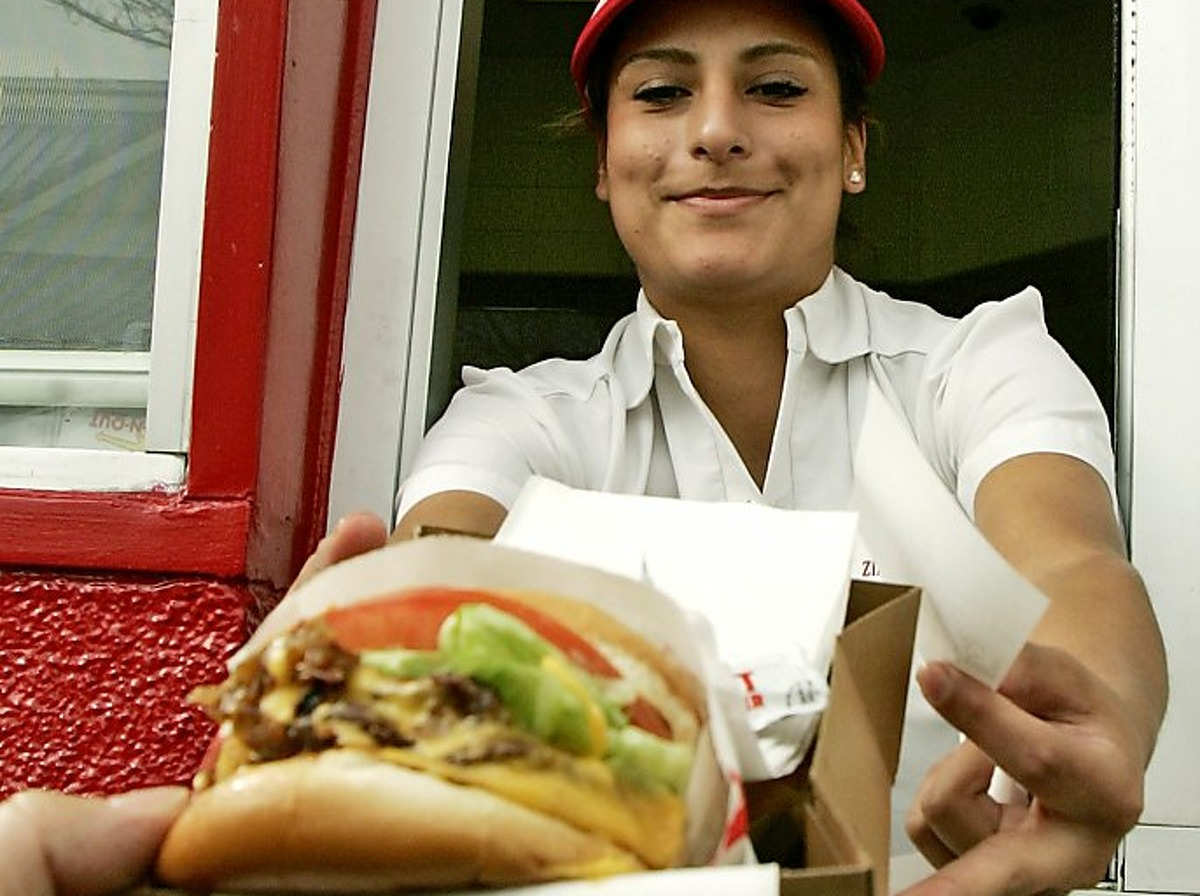 In this file photo, Zintya Casseras serves a hamburger at the In-N-Out restaurant in Los Angeles.