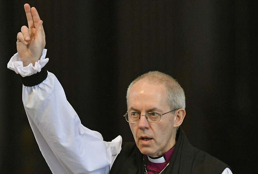 The Rt. Rev. Justin Welby gives a blessing as his election as archbishop of Canterbury is confirmed.