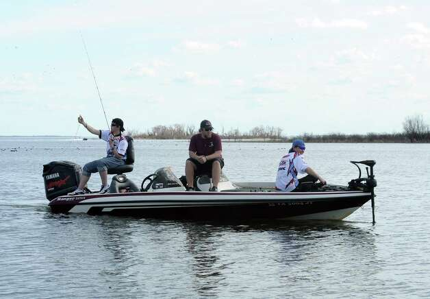 Lumberton High School angling team of Tyler Ozment and Zach Ruff look for the big bass at the Premier Yamaha's Lumberton High School Open on Saturday, February 2, 2013, at Lake Sam Rayburn. Photo taken: Randy Edwards/The Enterprise Photo: Randy Edwards