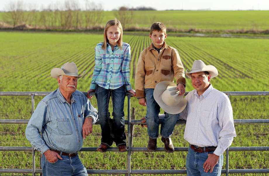 "Members of two Hondo farming families — Kenneth Bendele (from left), Ella Britsch, Brad Bendele and Eric Bendele — were in a Ram Super Bowl commercial. ""I didn't know we were even going to be on TV,"" Eric said. Photo: Edward A. Ornelas, San Antonio Express-News / © 2013 San Antonio Express-News"