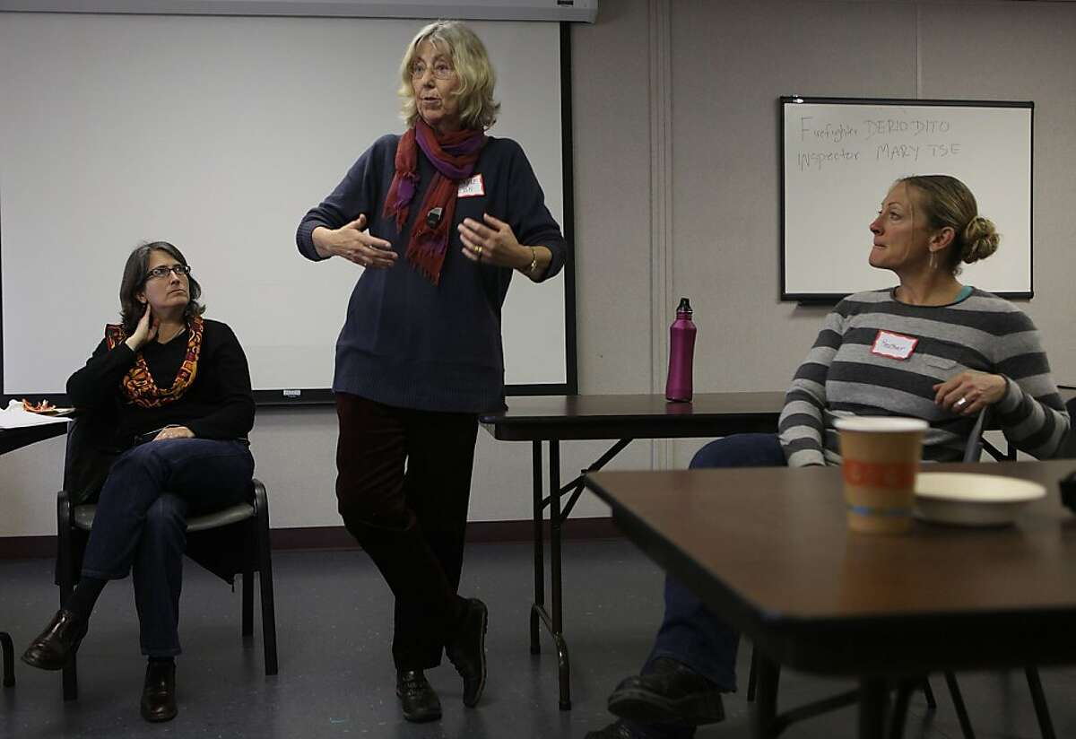 Rachel Morello-Frosch (left seated) from UC-Berkeley's school of public health, Sharyle Patton (speaking) from the Commonweal Biomonitoring program and firefighter Lt. Heather Buren (right) #5 at an informational meeting about cancer for female firefighters at fire station #7 in San Francisco, Calif., on Friday, January 25, 2013.