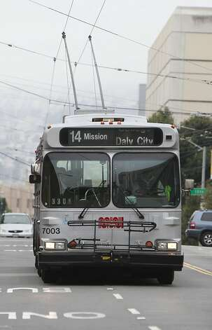 A 14 Mission line Muni bus makes drives in two lanes of traffic as it travels east bound on Mission Street on Monday, February 4, 2013 in San Francisco, Calif. Photo: Lea Suzuki, The Chronicle