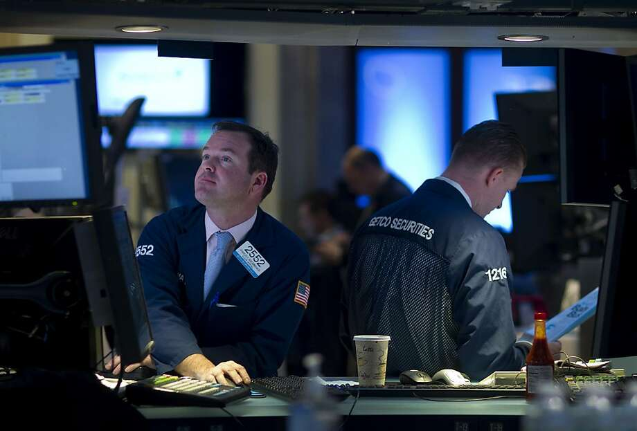 Charles Boeddinghaus works at the New York Stock Exchange. Investments are up, Vanguard says. Photo: Jin Lee, Bloomberg