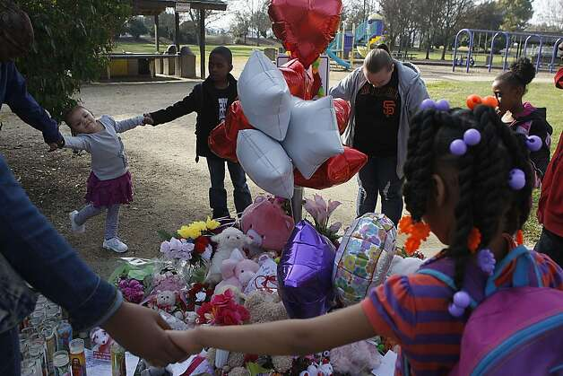 Parents and children from the nearby Sheldon Elementary school pray for the 13-year-old Green Valley Middle School student Janelle Allen at her memorial in Allan Witt Park in Fairfield, Calif., on Monday, February 4, 2013.  She was found strangled, dead and naked at the parking lot of the park.  These parents have been walking children home from school that usually cross this park because of someone harassing the children three weeks prior on their way to school. Photo: Liz Hafalia, The Chronicle