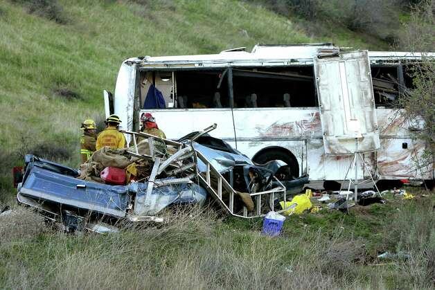 Investigators continue to work the scene of a bus crash that happened overnight on Highway 38 that killed at least 8 people on Monday, Feb. 4, 2013. California Highway Patrol spokesman Mario Lopez said Monday morning that the number of eight confirmed deaths was expected to rise because the coroner was just starting to remove bodies from the mangled vehicles and also take away the remains of those who were ejected. (AP Photo/The Press-Enterprise, Stan Lim)  NO SALES; MAGS OUT; MANDATORY CREDIT Photo: Stan Lim