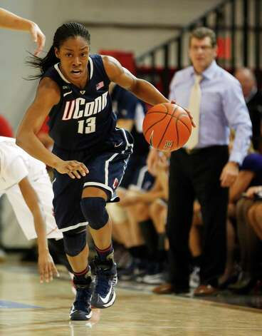 Connecticut guard Brianna Banks (13) breaks away during the first half of a NCAA college basketball game against St. John's, Saturday, Feb. 2, 2013, at St. John's University in New York. (AP Photo/John Minchillo) Photo: John Minchillo, Associated Press / FR170537 AP