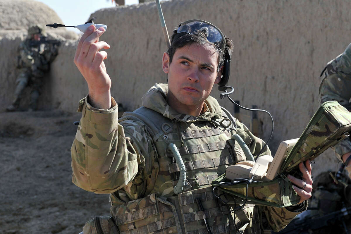 British Army Sgt. Scott Weaver of the Queens Royal Lancers launches one of the world's smallest drones from a compound in Afghanistan. Photo: U.K. Ministry of Defence