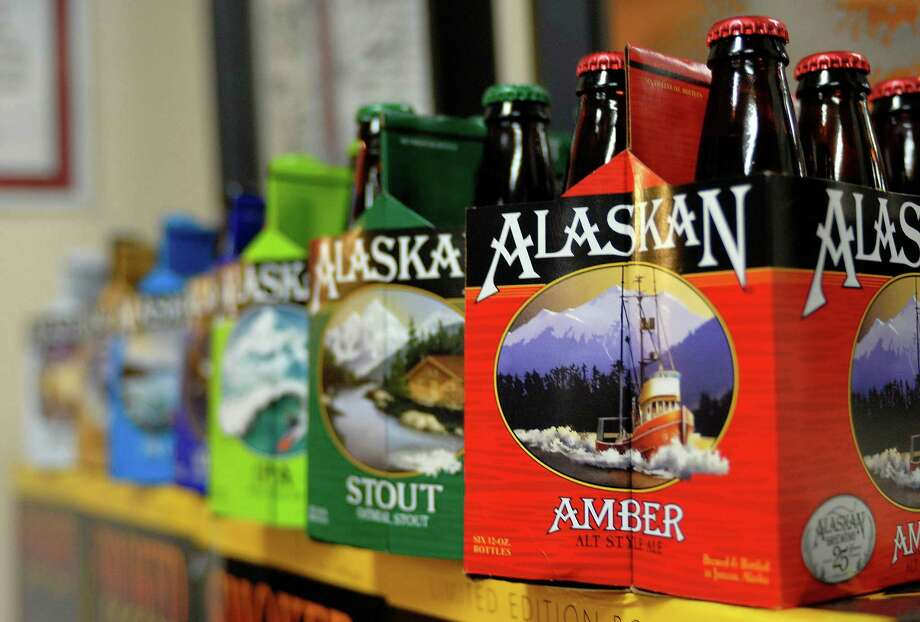 In this photo taken Jan 23, 2013, in Juneau, Alaska, are six-packs of beer displayed at the Alaskan Brewing Co. The brewery has installed a unique boiler system that burns the company's spent grain the accumulated waste from the brewing process into steam which powers the majority of the plant's operations. (AP Photo/Joshua Berlinger) Photo: Joshua Berlinger