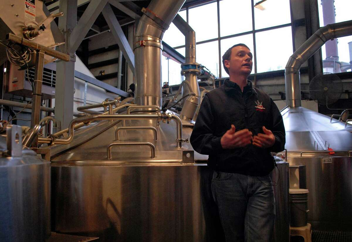 In this photo taken Jan 23, 2013, in Juneau, Alaska, Brandon Smith, the Alaskan Brewing Co.'s brewing operations and engineering manager, speaks to reporters about the company's new boiler system. The brewery has installed a unique boiler system that burns the company's spent grain the accumulated waste from the brewing process into steam which powers the majority of the plant's operations. (AP Photo/Joshua Berlinger)
