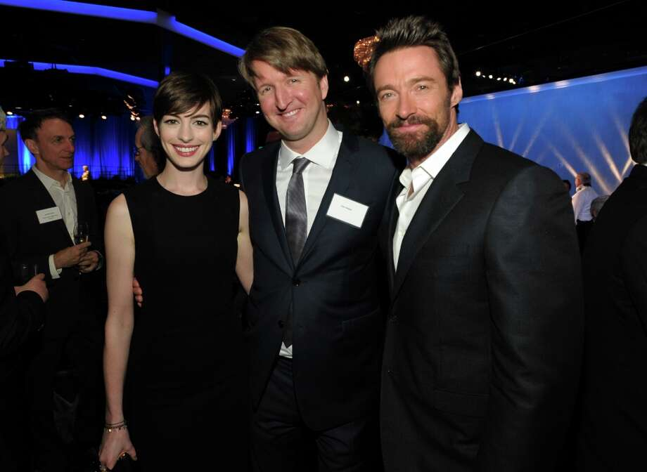 Anne Hathaway, left, nominated for best actress in a supporting role, left, and Hugh Jackman, right, nominated for best actor in a leading role, for Les Miserables, pose with director Tom Hooper at the 85th Academy Awards Nominees Luncheon at the Beverly Hilton Hotel on Monday, Feb. 4, 2013, in Beverly Hills, Calif. (Photo by John Shearer/Invision/AP) Photo: John Shearer, Associated Press / Invision