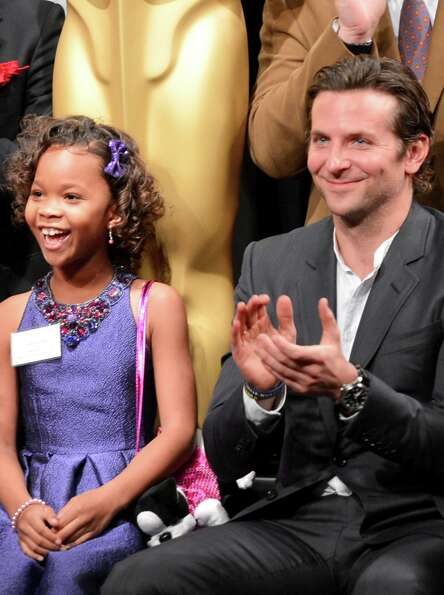 BEVERLY HILLS, CA - FEBRUARY 04:  Actress Quvenzhané Wallis (L) and Bradley Cooper attend the 85th