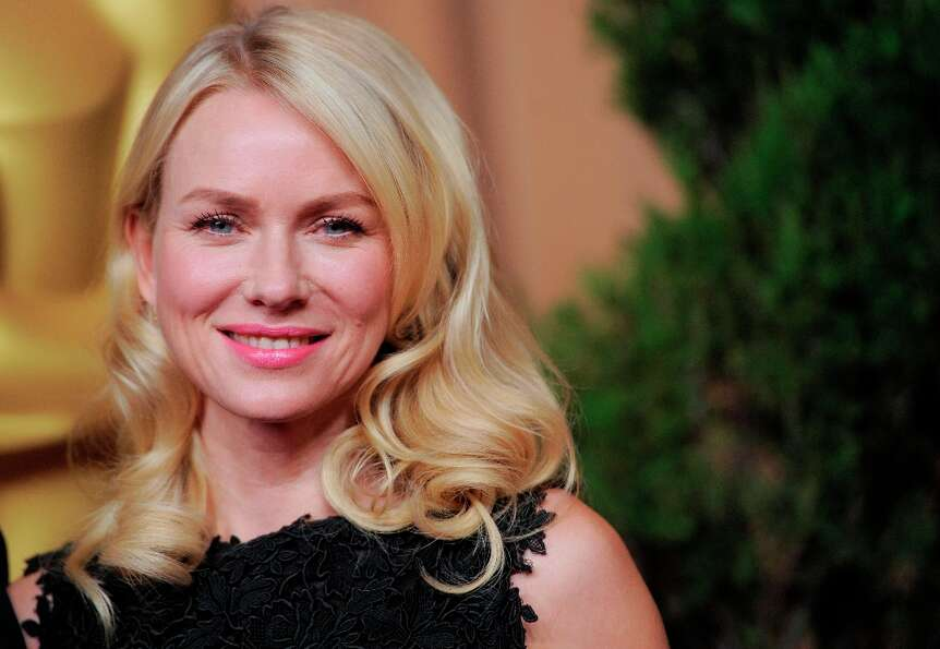 Naomi Watts, nominated for best actress in a leading role for The Impossible, arrives at the 85th Ac