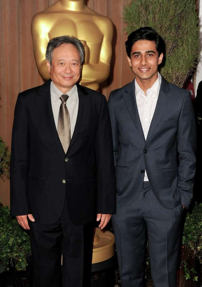 BEVERLY HILLS, CA - FEBRUARY 04:  Director Ang Lee (L) and actor Suraj Sharma attend the 85th Academy Awards Nominations Luncheon at The Beverly Hilton Hotel on February 4, 2013 in Beverly Hills, California. Photo: Kevin Winter, Getty Images / 2013 Getty Images