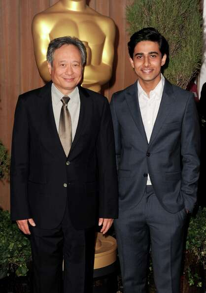 BEVERLY HILLS, CA - FEBRUARY 04:  Director Ang Lee (L) and actor Suraj Sharma attend the 85th Academ