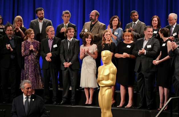 BEVERLY HILLS, CA - FEBRUARY 04:  Production Designer Sarah Greenwood, Director/actor Ben Affleck, Costume Designer Colleen Atwood, actor Denzel Washington, Producer Kathleen Kennedy, Director Tim Burton, actress Amy Adams, sound editor Per Hallberg, actor Joaquin Phoenix, actresses Sally Field, Anne Hathaway and other Oscar Nominees pose together for the 85th Academy Awards Nominations Luncheon at The Beverly Hilton Hotel on February 4, 2013 in Beverly Hills, California. Photo: Alberto E. Rodriguez, Getty Images / 2013 Getty Images