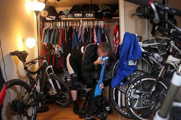 "Bobby McMullen locates a jacket in his ""office"" - a room filled with bicycles and gear - January 24, 2013 in Mill Valley, Calif. McMullen is an avid and accomplished skier, mountain biker, and road cyclist who is also blind. Because of McMullen's condition, he has to rely on his memory to locate objects in his house. Photo: Pete Kiehart, The San Francisco Chronicle"