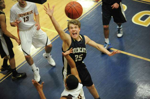 Rye Country Day School's # 25 James McPhail gets a rebound against Brunswick during a basketball game hosted by Rye Country Day School, in Rye, N.Y., Monday, Feb. 4, 2013. Photo: Helen Neafsey / Greenwich Time