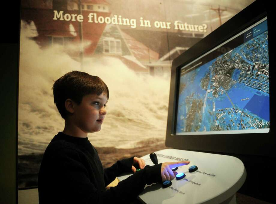 Liam Flanagan-Brown, 9 of Meriden, uses an interactive screen showing the rise in coastal flooding in the new global warming exhibit at the Peabody Museum in New Haven on Wednesday, January 30, 2013. Photo: Brian A. Pounds