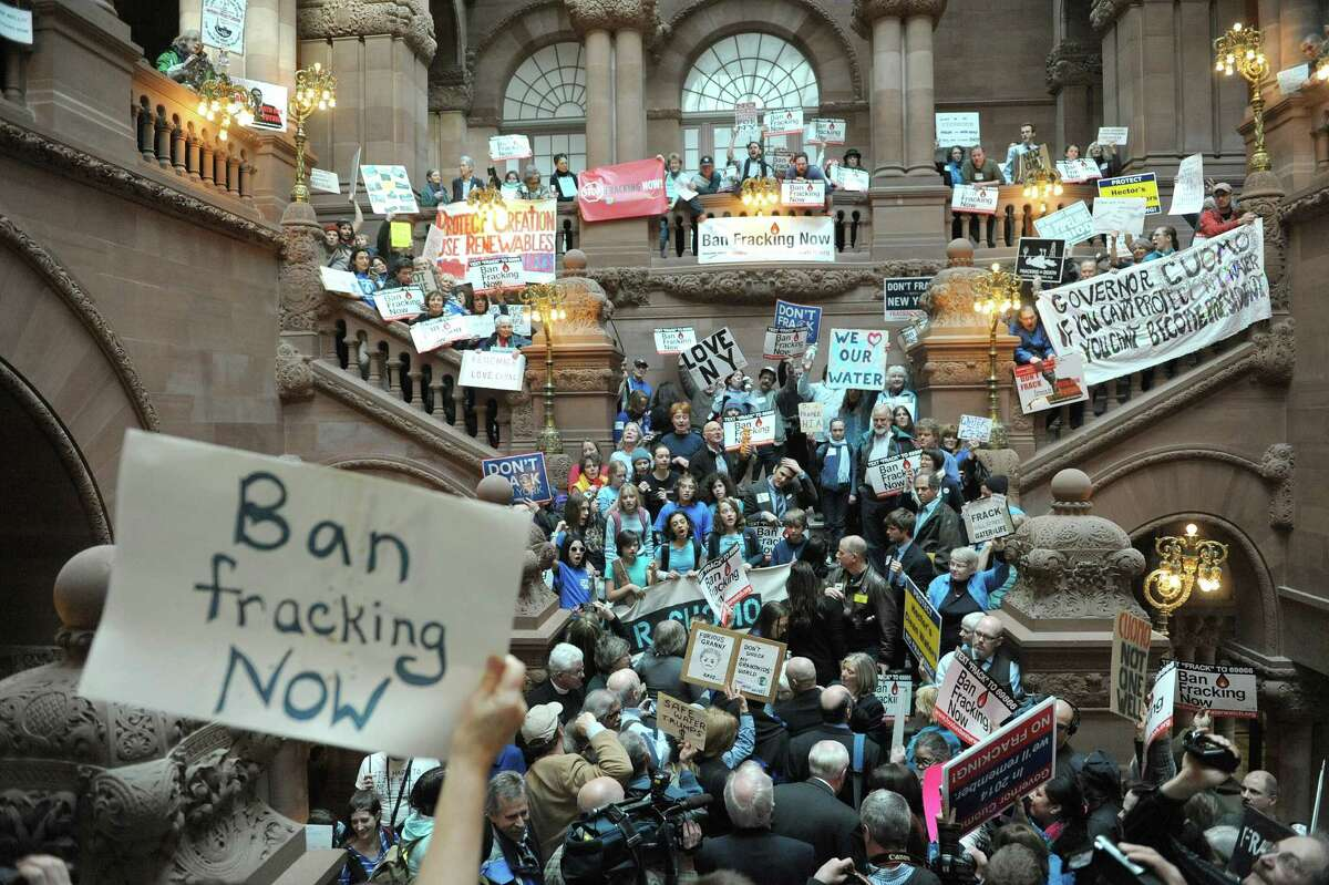 Protestors who are against the State allowing hydraulic fracturing, hold a rally on the Million Dollar Staircase inside the Capitol on Monday, Feb. 4, 2013 in Albany, NY. (Paul Buckowski / Times Union)