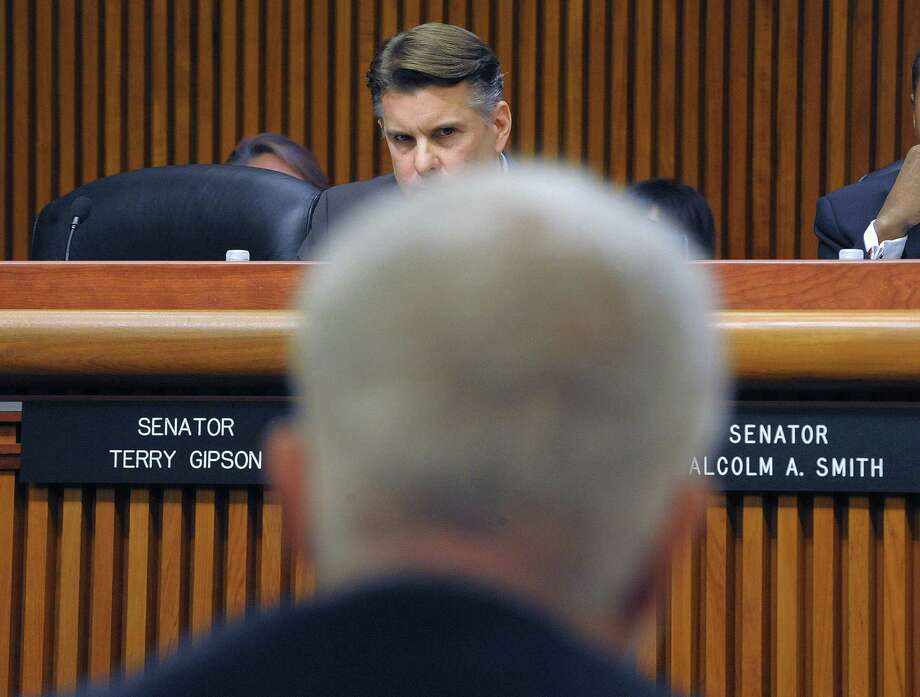 Senator Terry Gipson, listens as Joe Martens, the DEC commissioner answers the Senator's question during a joint legislative budget hearing on the environment on Monday, Feb. 4, 2013 in Albany, NY.  (Paul Buckowski / Times Union) Photo: Paul Buckowski  / 00021025A
