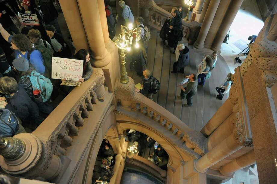 Protestors who are against the State allowing hydraulic fracturing, hold a rally on the  Million Dollar Staircase inside the Capitol on Monday, Feb. 4, 2013 in Albany, NY.  (Paul Buckowski / Times Union) Photo: Paul Buckowski