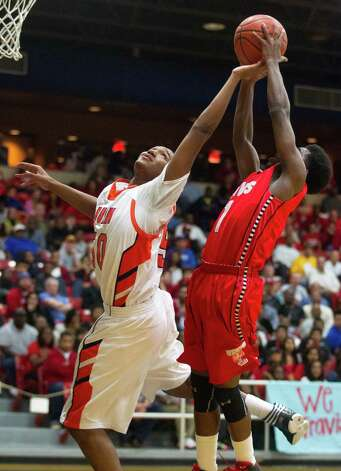 Bush's Ladarius Johnson (50) and Travis' John Burnett fight for the rebound during the first half of a high school basketball game at Wheeler Field House on Monday, Feb. 4, 2013, in Sugar Land. Photo: J. Patric Schneider, For The Chronicle / © 2013 Houston Chronicle