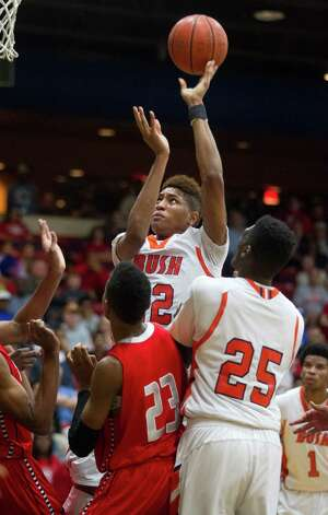 Bush's Kelly Oubre (12) puts up a shot during the first half of a high school basketball game against Travis at Wheeler Field House on Monday, Feb. 4, 2013, in Sugar Land. Photo: J. Patric Schneider, For The Chronicle / © 2013 Houston Chronicle