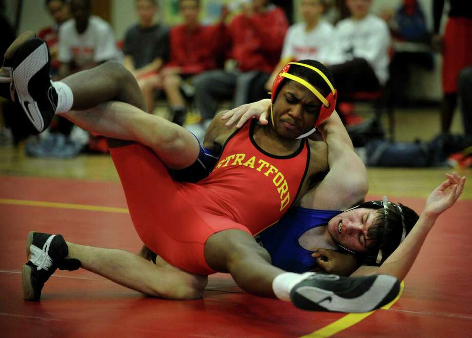 Stratford's Richard Francois defeats rival Bunnell's Eric Ross in a close match in the 145 pound class during their wrestling meet at Stratford High School on Monday, February 4, 2013. Photo: Brian A. Pounds