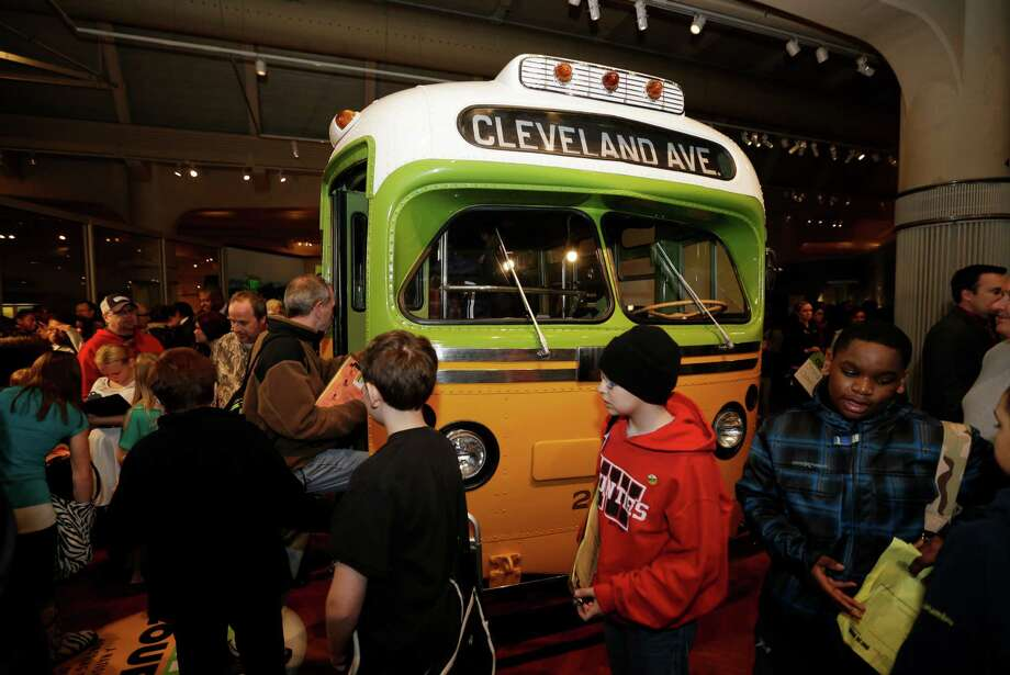Visitors to The Henry Ford in Dearborn, Mich.,  board the Rosa Parks bus, Monday, Feb. 4, 2013. Earlier in the day the Rosa Parks' 100th birthday commemorative postage stamp was unveiled at the museum.(AP Photo/Carlos Osorio) Photo: Carlos Osorio, STF / AP