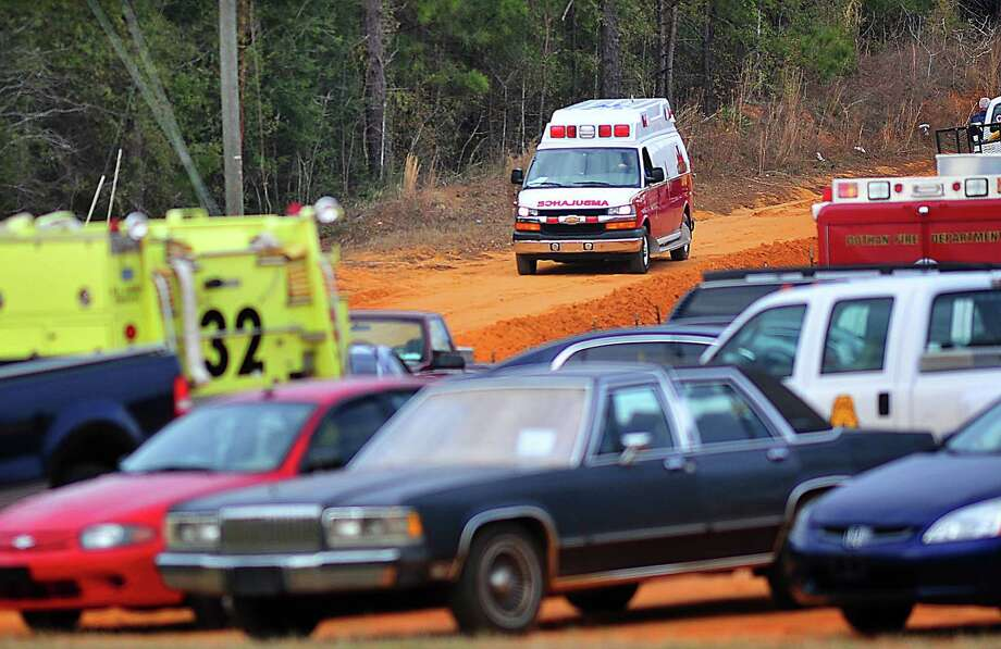 An Ozark, Ala., ambulance carries the boy named Ethan out of the area where a gunman has held him hostage since last Tuesday. Authorities stormed the underground bunker Monday, Feb. 4, 2013, freeing the 5-year-old boy who had been held hostage for nearly a week in the tiny underground shelter and leaving the boy's abductor dead. (AP Photo/The Dothan Eagle, Jay Hare) Photo: Jay Hare, Associated Press / Dothan Eagle