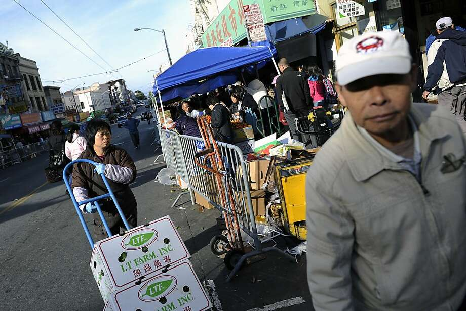 Tarp-covered stalls replace parking places on busy Stockton Street — but it's only for two weeks. Photo: Michael Short, Special To The Chronicle