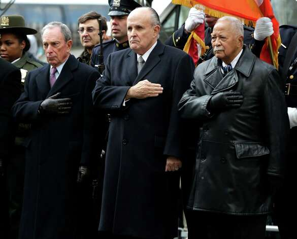 Mayor Michael Bloomberg, left, and former Mayors Rudolph Giuliani, center, and David Dinkins put their hands over their hearts as a casket containing the body of former New York City Mayor Ed Koch leaves a synagogue after his funeral in New York, Monday, Feb. 4, 2013. Koch was remembered as the quintessential New Yorker during a funeral that frequently elicited laughter, recalling his famous one-liners and amusing antics in the public eye. (AP Photo/Seth Wenig) Photo: Seth Wenig