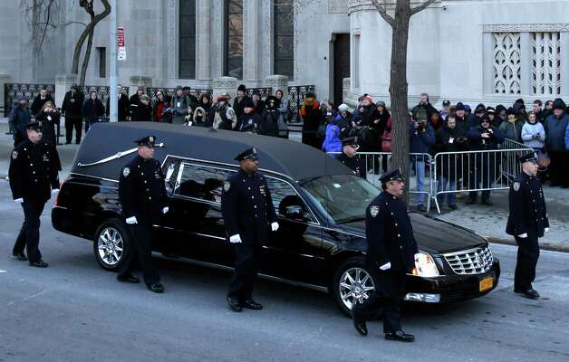 Police escort the hearse containing the body of former New York City Mayor Ed Koch to Emple Emanu-El for his funeral in New York, Monday, Feb. 4, 2013.  Koch died Friday of congestive heart failure at age 88.  (AP Photo/Seth Wenig) Photo: Seth Wenig