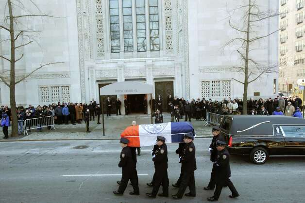 The casket containing the body of former New York City Mayor Ed Koch is carrfied by policemen  into Temple Emanu-El for his funeral in New York, Monday, Feb. 4, 2013.  Koch died Friday of congestive heart failure at age 88.  (AP Photo/Seth Wenig) Photo: Seth Wenig