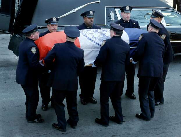 The casket containing the body of former New York City Mayor Ed Koch is arrives at Temple Emanu-El for his funeral in New York, Monday, Feb. 4, 2013.  Koch died Friday of congestive heart failure at age 88.  (AP Photo/Seth Wenig) Photo: Seth Wenig