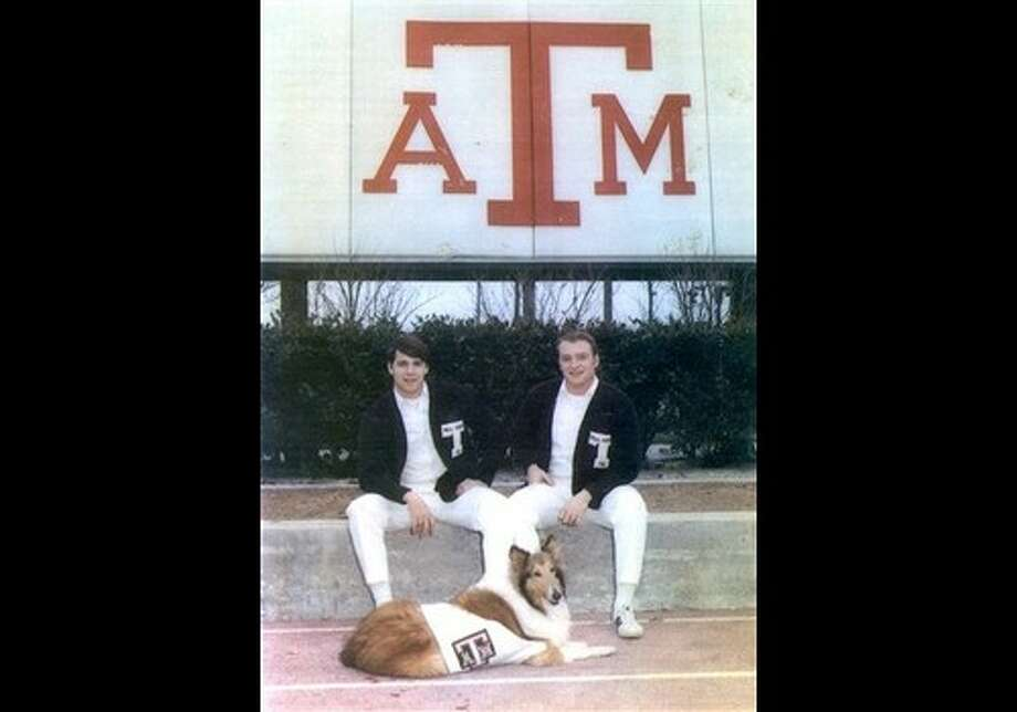 This 1971 provided by the Perry Campaign shows Texas A&M University yell leaders Rick Perry, left, and Tommy Orr with dog Reveille III, the TAMU mascot, at College Station, Texas. Photo: AP / Perry Campaign