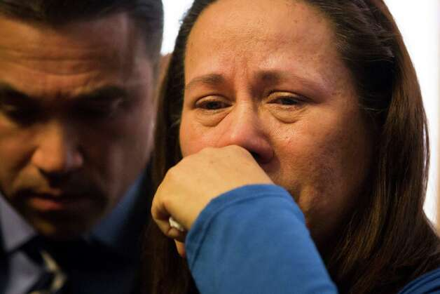 Betzaida Jimenez, mother of 33-year-old Sarai Sierra who was found dead on Saturday in Turkey, pauses during a news conference at a friend's home in Staten Island, Monday, Feb. 4, 2013, in New York. Sierra went missing while vacationing alone in Istanbul on Jan. 21, the day she was due to board her flight back home.   Congressman Michael Grimm is at left. (AP Photo/John Minchillo) Photo: John Minchillo