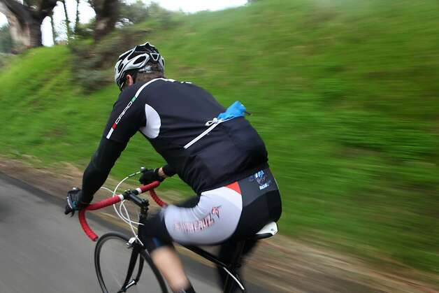 Bobby McMullen rides his bicycle in Mill Valley. McMullen is an avid and accomplished skier, mountain biker, and road cyclist who is also blind. Photo: Pete Kiehart, The San Francisco Chronicle