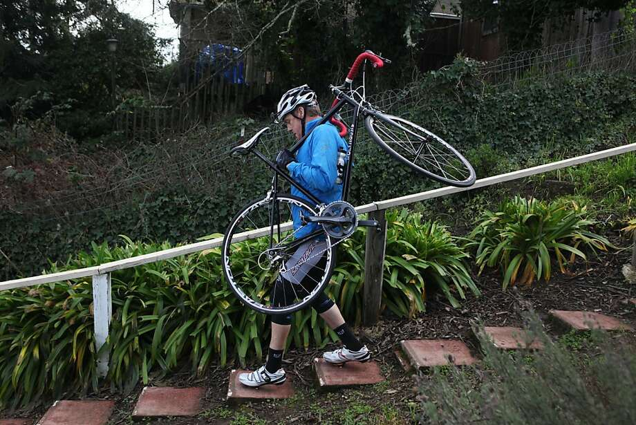 Bobby McMullen feels his way down the stairs in front of his house on January 24, 2013 in Mill Valley, Calif. McMullen is an avid and accomplished skier, mountain biker, and road cyclist who is also blind. Photo: Pete Kiehart, The San Francisco Chronicle