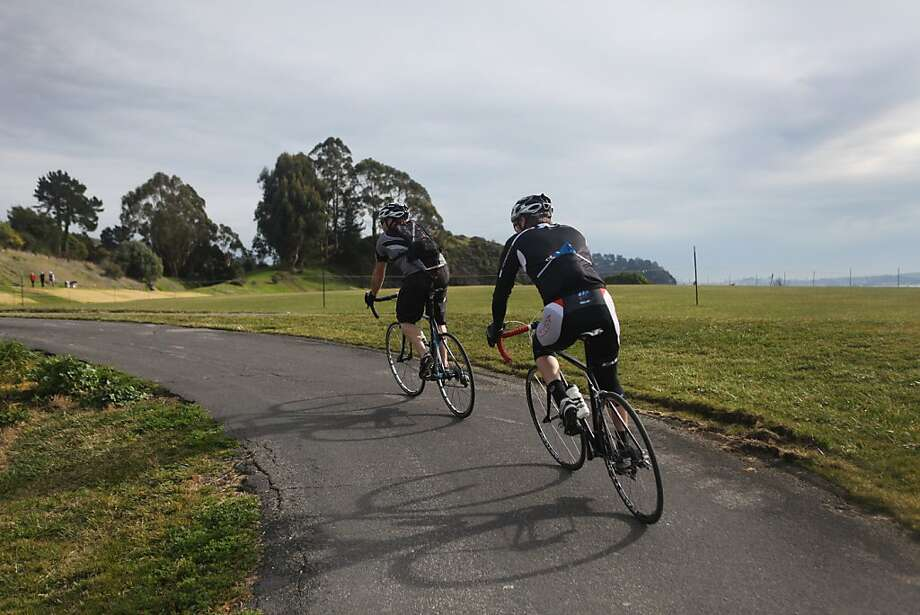 Brad Waldron leads Bobby McMullen on a bike ride past McKegney Field on January 24, 2013 in Tiburon, Calif. McMullen's friends act as guides by shouting descriptions of turns and aberrations on the road to the blind McMullen when they go on bike rides. McMullen is an avid and accomplished skier, mountain biker, and road cyclist who is also blind. Photo: Pete Kiehart, The San Francisco Chronicle