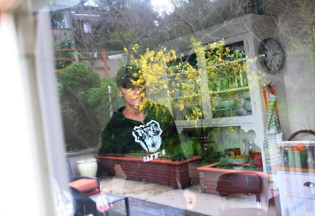 Bobby McMullen is seen through a window in his kitchen on in Mill Valley. McMullen is an avid and accomplished skier, mountain biker, and road cyclist who is also blind. Photo: Pete Kiehart, The San Francisco Chronicle