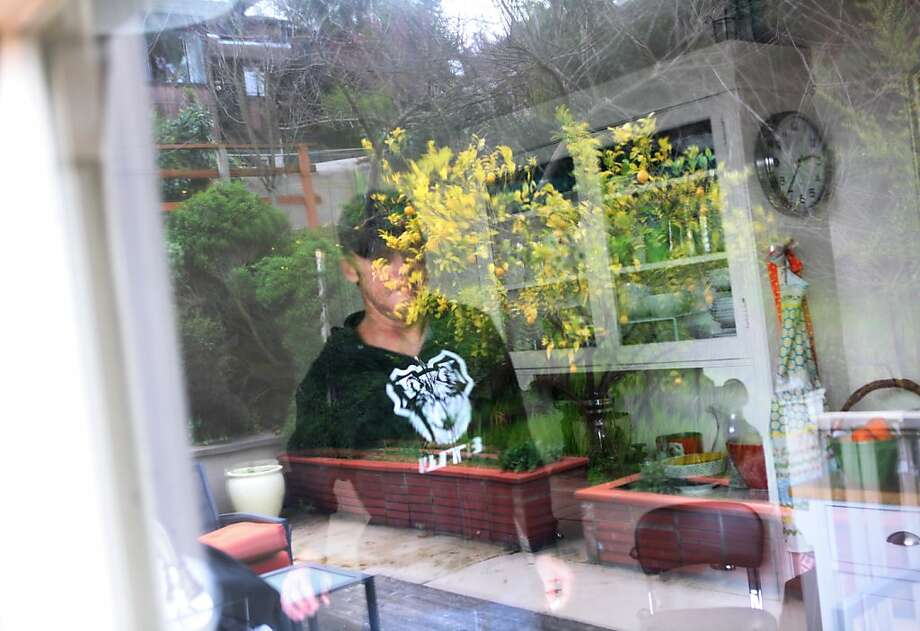 Bobby McMullen is seen through a window in his kitchen on January 24, 2013 in Mill Valley, Calif. McMullen is an avid and accomplished skier, mountain biker, and road cyclist who is also blind. Photo: Pete Kiehart, The San Francisco Chronicle