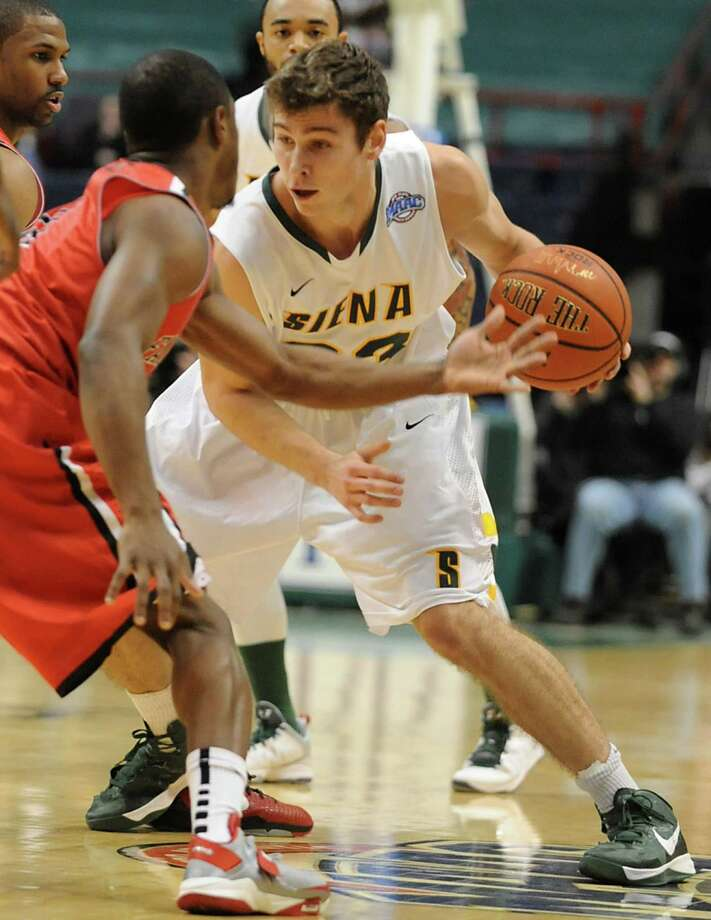Siena's Rob Poole dribbles up the court during a basketball game against Fairfield at the Times Union Center on Monday Feb. 4, 2013 in Albany, N.Y. (Lori Van Buren / Times Union) Photo: Lori Van Buren