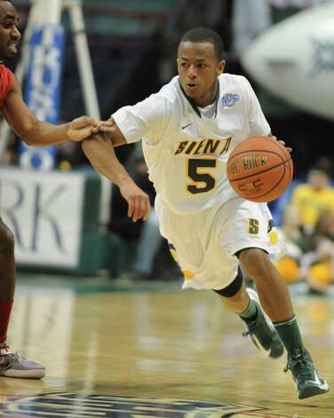 Siena's Evan Hymes dribbles the ball up the court during a basketball game against Fairfield at the Times Union Center on Monday Feb. 4, 2013 in Albany, N.Y. (Lori Van Buren / Times Union) Photo: Lori Van Buren