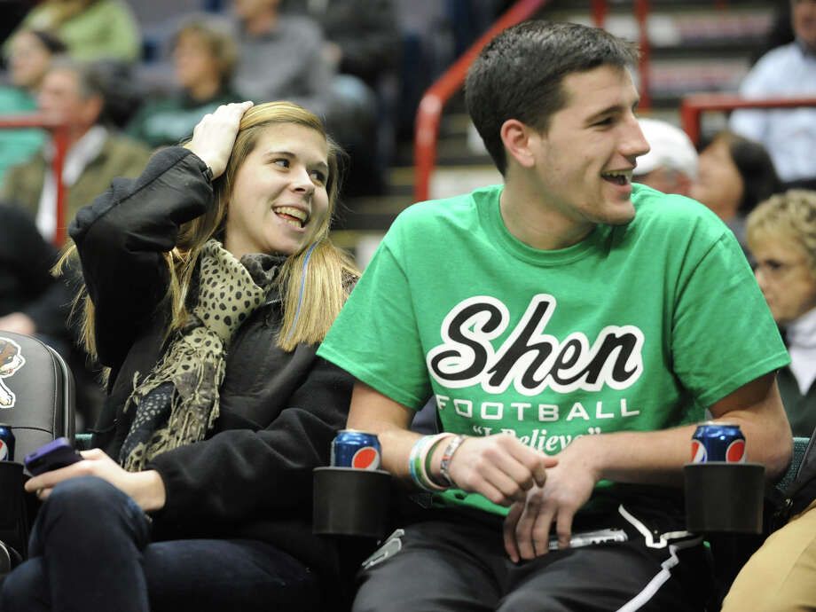 Shaker High School student Baily Wind and Shenendehowa High School Student Matt Hardy laugh with their friends while watching a Siena basketball game against Fairfield at the Times Union Center on Monday Feb. 4, 2013 in Albany, N.Y. (Lori Van Buren / Times Union) Photo: Lori Van Buren