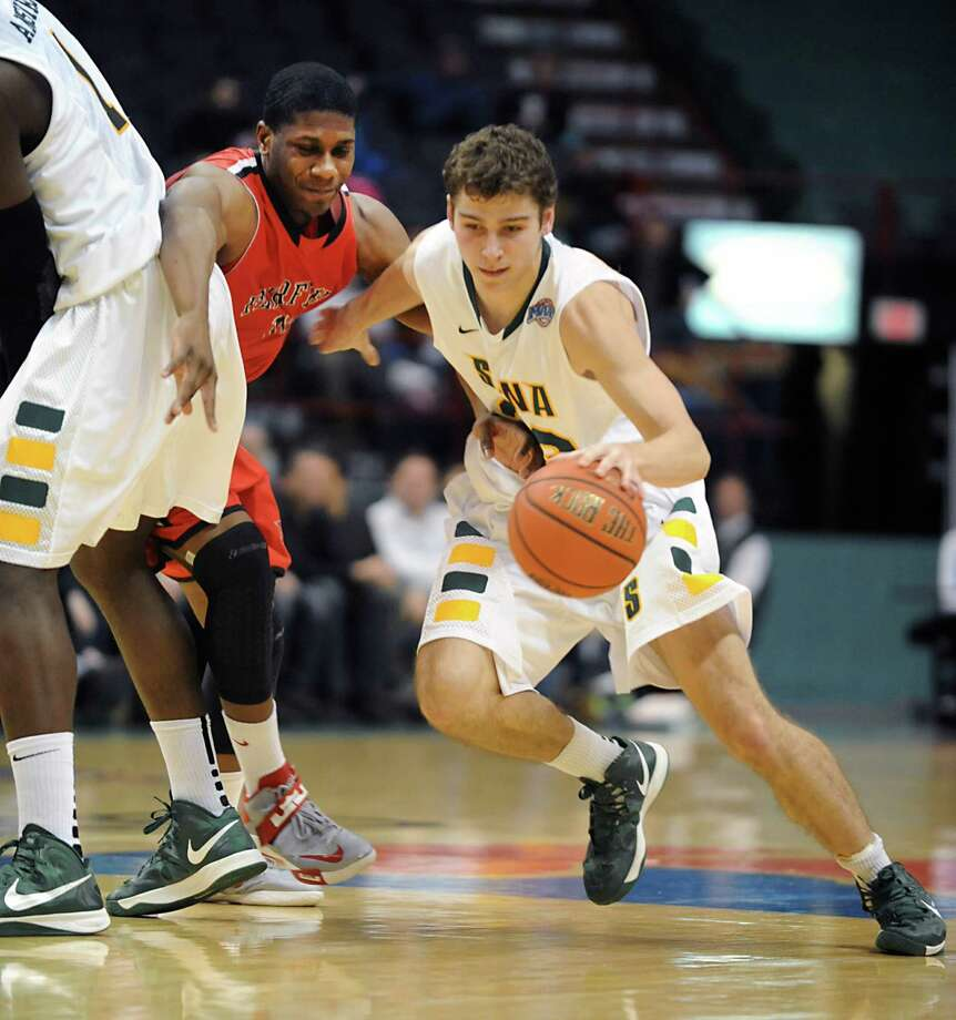 Siena's Rob Poole uses a screen by O.D. Anosike to lose a Fairfield player during a basketball game at the Times Union Center on Monday Feb. 4, 2013 in Albany, N.Y. (Lori Van Buren / Times Union) Photo: Lori Van Buren