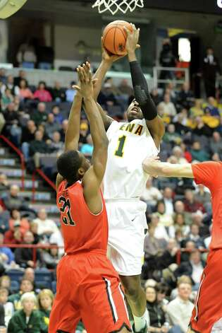 Siena's O.D. Anosike drives to the basket during a basketball game against Fairfield at the Times Union Center on Monday Feb. 4, 2013 in Albany, N.Y. (Lori Van Buren / Times Union) Photo: Lori Van Buren