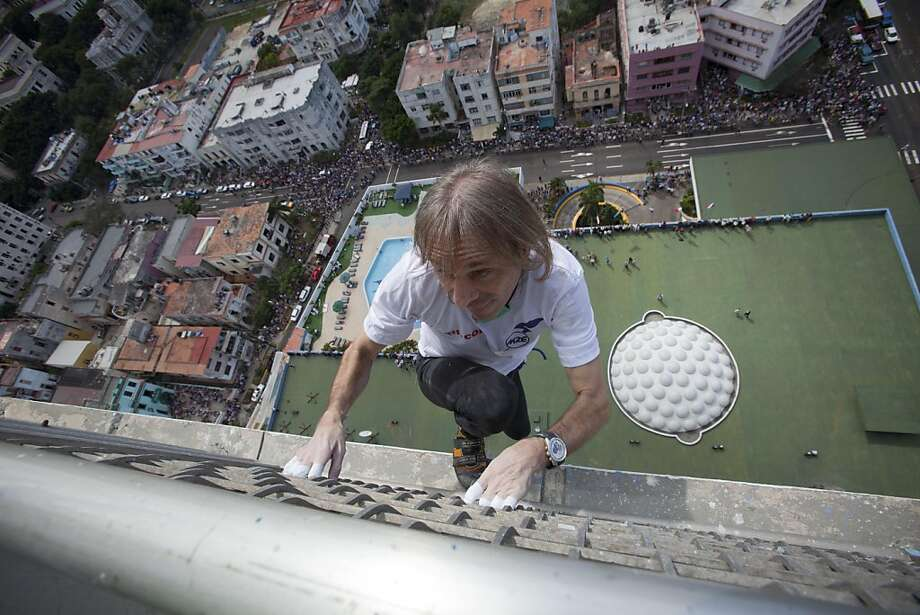 French daredevil Alain Robert scales the Habana Libre hotel without using ropes or a safety net, in Havana, Cuba, Monday, Feb. 4, 2013. Once the city's Hilton, Robert was able to reach the top of the 27-story building in 30 minutes. Robert has scaled much taller buildings in his career. He says his main concern is that the hotel is in disrepair like other Havana landmarks. Photo: Ramon Espinosa, Associated Press